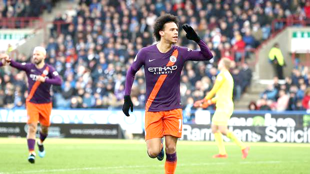 City ease past Huddersfield