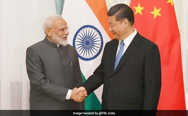 Modi, Xi to begin 2-day informal summit  to reconfigure ties hit by Kashmir issue