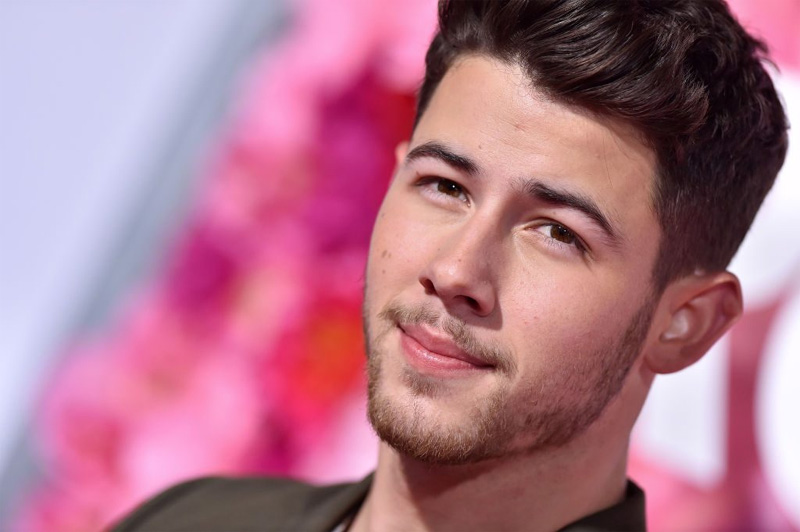 Nick Jonas gets groped by a fan during LA concert