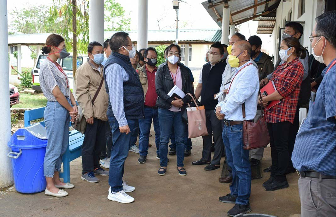 T.R. Zeliang interacts with medical staff at Jalukie 1