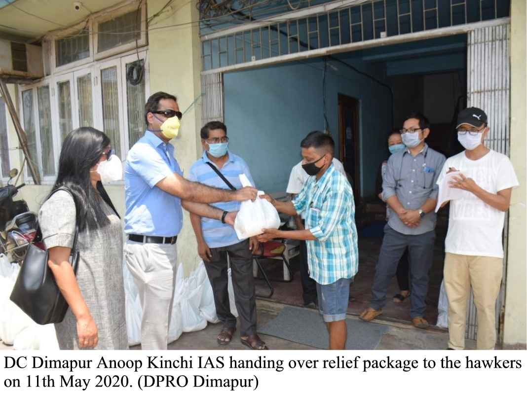 DC Dimapur hands over relief to hawkers 1
