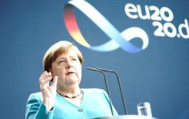 Angela Merkel applauds 'impressive' women