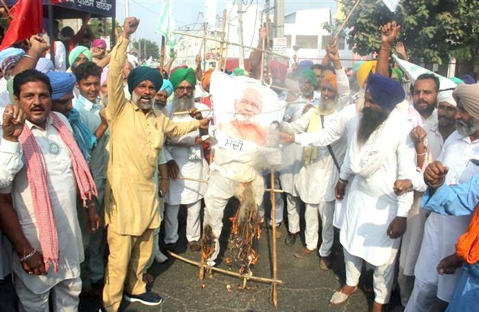 burn effigies of PM