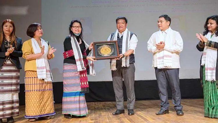 Arunachal CM presenting Women's Day award