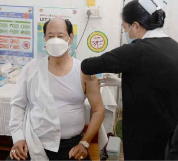 Chief Minister Neiphiu Rio taking the second dose of the COVID 19 vaccine