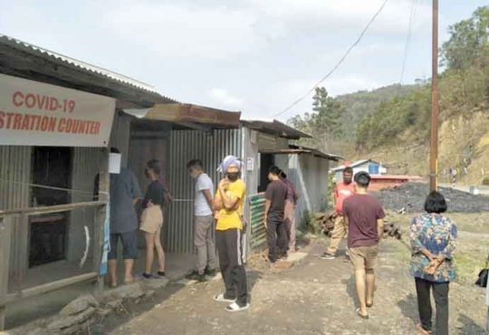 Travellers registering details at Peducha Check Gate