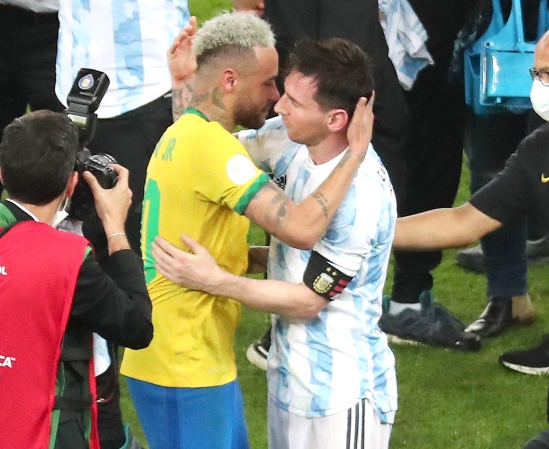 Neymar hugs Messi
